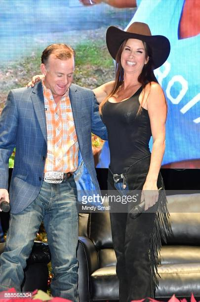 Flint Rasmussen poses with actress Debbie Dunning during the Outside the Barrel with Flint Rasmussen show during the National Finals Rodeo's Cowboy...