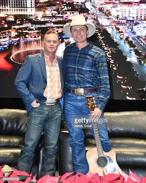 Flint Rasmussen poses with recording artist Ned LeDoux during the Outside the Barrel with Flint Rasmussen show during the National Finals Rodeo's...