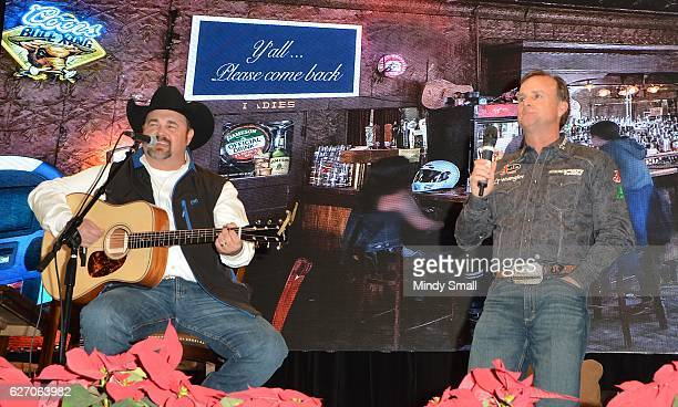 Flint Rassmussen sings with Daryle Singletary during the Keepin' it Country with Daryle Singletary show during the National Finals Rodeo's Cowboy...