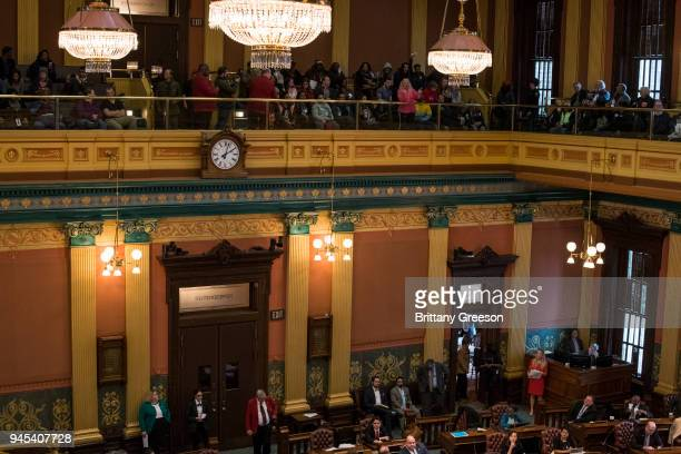 Flint residents and allies from regions nearby disrupt the state legislature with a chant in protest of the closing water distribution sites at the...