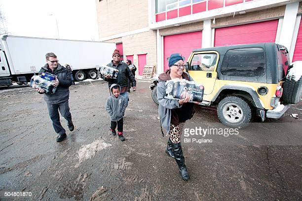 Flint residents get bottled water water testing kits and water filters at a Flint Fire Station January 13 2016 in Flint Michigan On Tuesday Michigan...