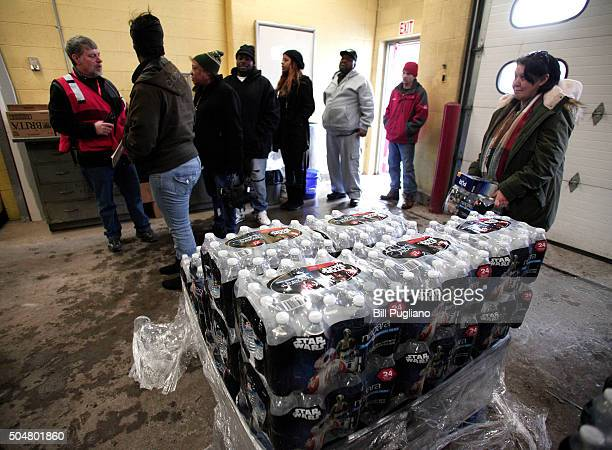 Flint residents line up to get bottled water water testing kits and water filters at a Flint Fire Station January 13 2016 in Flint Michigan On...