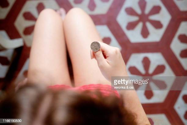 flip a coin - flipping a coin stock pictures, royalty-free photos & images