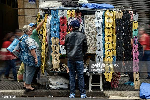 Flip flops are sold at Rua 25 de Marco, Sao Paulo, Brazil on Saturday June 7th , 2014. Sao Paulo-based Alpargatas SA, the maker of the Havaianas...