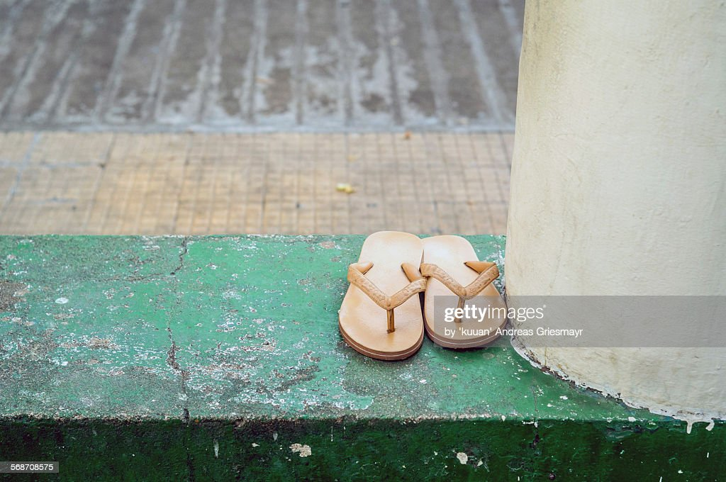Flip Flops at the swimming pool : Stock Photo