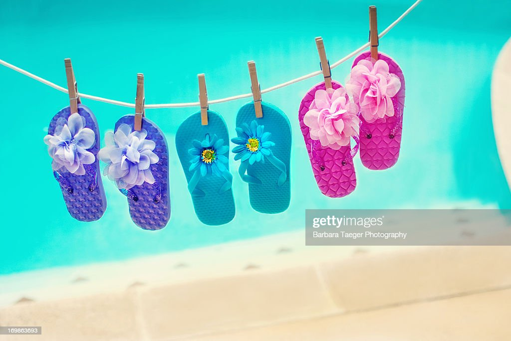 0cfd5e410019a4 Flip flops on a clothesline   Stock Photo