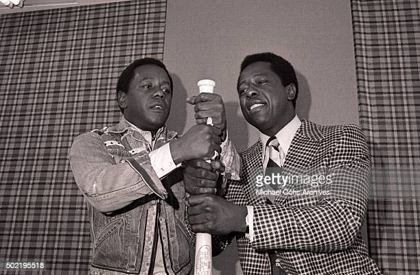 Flip Wilson and Hank Aaron have fun with a bat during a press conference before filming NBCTV's The Flip Wilson Show on October 15 1973 in Hollywood...