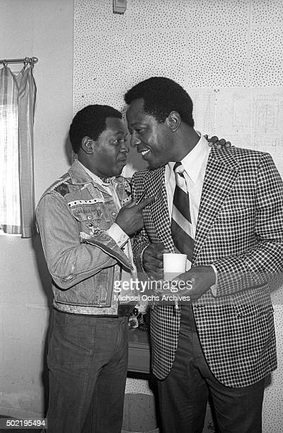 Flip Wilson and Hank Aaron talk to each other during a press conference before filming NBCTV's The Flip Wilson Show on October 15 1973 in Hollywood...