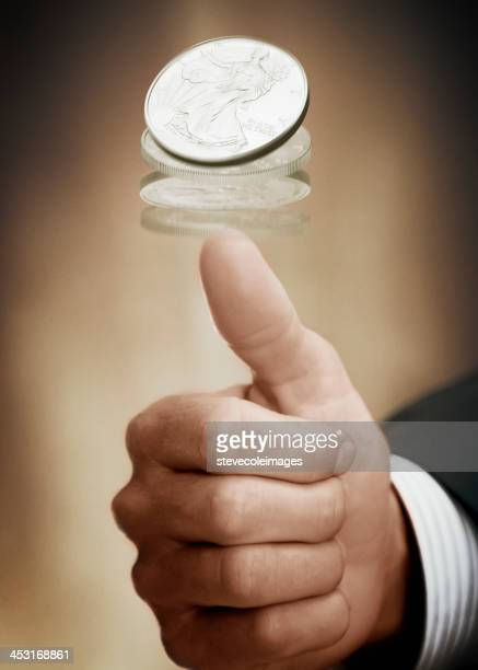 flipping a coin - flipping a coin stock pictures, royalty-free photos & images