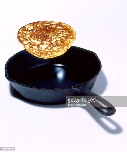 Flipping pancake in frying pan