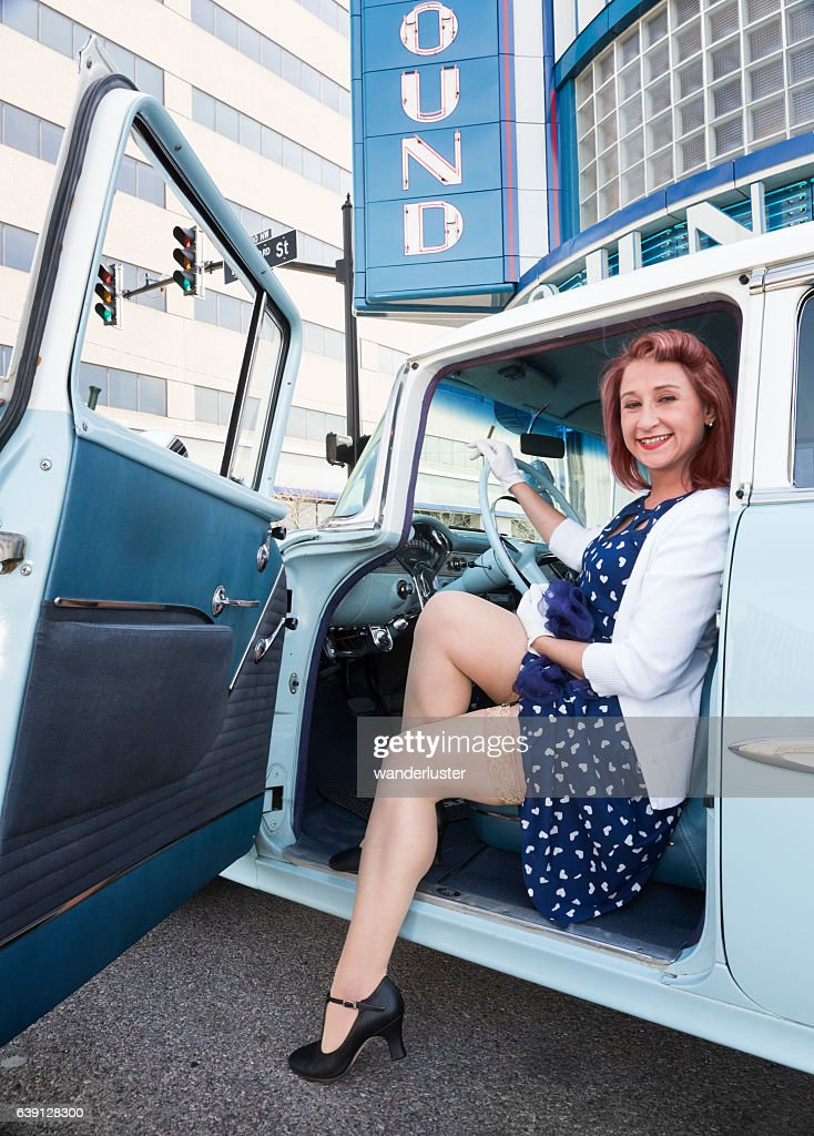 Flirtatious Young Woman In Vintage Car High-Res Stock ...
