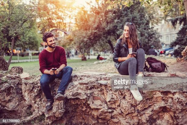 flirting couple in the city park - i love you stock pictures, royalty-free photos & images