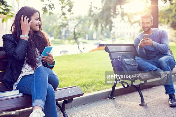 flirting couple in the park - flirting stock pictures, royalty-free photos & images
