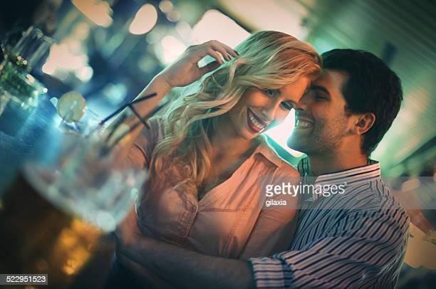 Flirting in a bar.