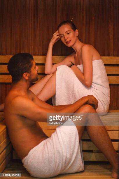 flirting in sauna - black woman in sauna stock pictures, royalty-free photos & images