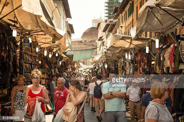 flirting man tourists in street market firenze italy - florence italy stock pictures, royalty-free photos & images