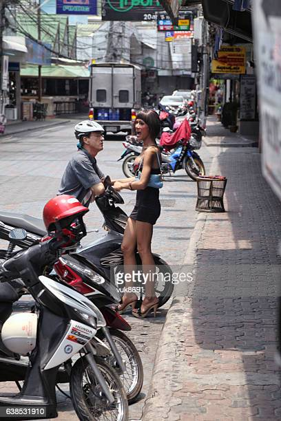 flirting - thailand prostitutes stock photos and pictures