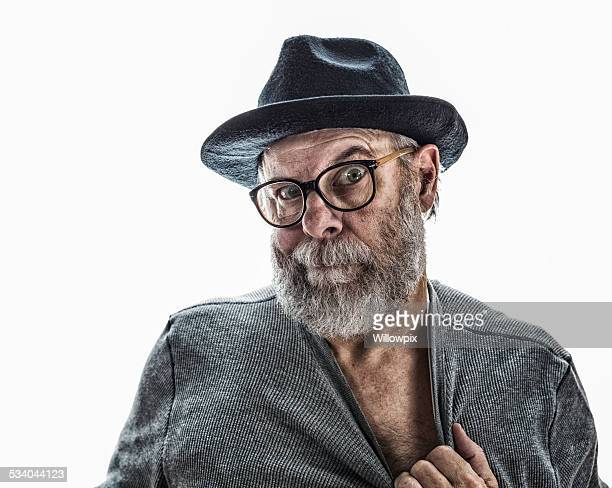flirting senior man wearing black fedora hat - male flashers stock photos and pictures