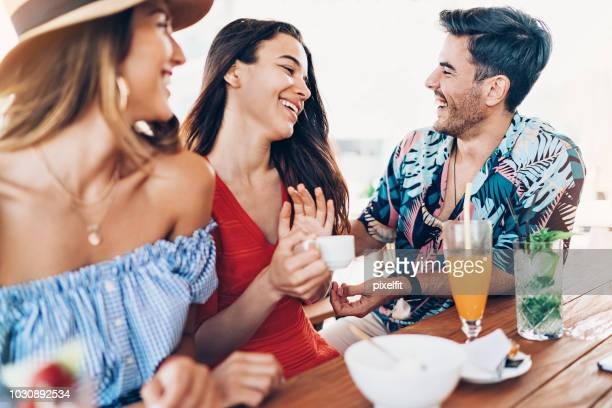 flirting with the girls in a summer bar - hawaiian shirt stock photos and pictures