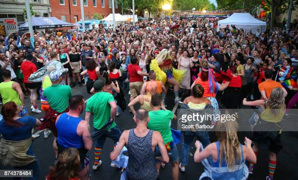 A 'fllash mob' perform in front of supporters of the 'Yes' vote for marriage equality at Melbourne's Result Street Party on November 15 2017 in...