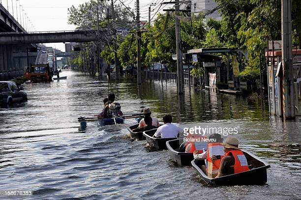 Fllooded neighborhood of Bang Phlat and Taling Chan on the western side of the Chaopraya river Distribution of Food supplies and water from an Thai...