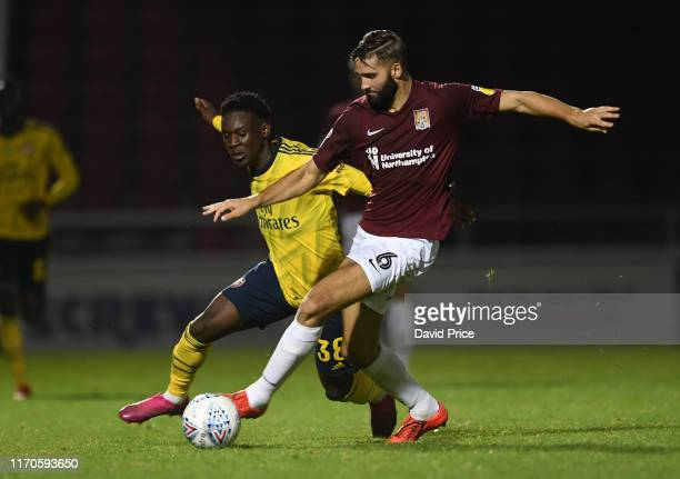 Flo Balogun of Arsenal challenges Jordan Turnbull of Northampton during the Leasingcom match between Northampton Town and Arsenal U21 at PTS Academy...