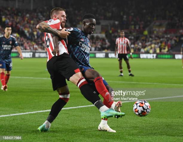 Flo Balogun of Arsenal holds off Pontus Jansson of Brentford during the Premier League match between Brentford and Arsenal at Brentford Community...