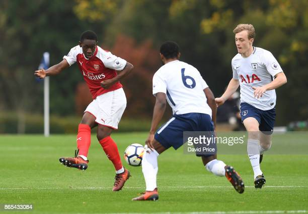 Flo Balogun of Arsenal is closed down by Oliver Skipp and Japhet Tanganga of Tottenham during the match between Tottehma Hotspur and Arsenal on...