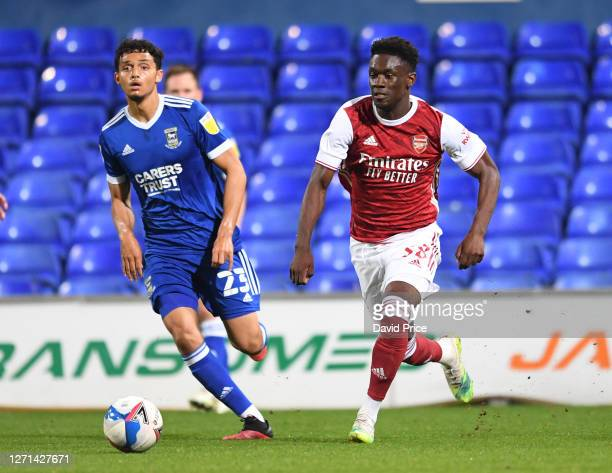 Flo Balogun of Arsenal takes on Andre Dozzell of Ipswich during the Leasingcom Cup match between Ipswich Town and Arsenal U21 at Portman Road on...