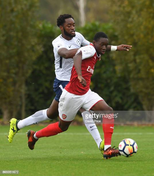 Flo Balogun of Arsenal takes on Christian Maghoma of Tottenham during the match between Tottehma Hotspur and Arsenal on October 23 2017 in Enfield...