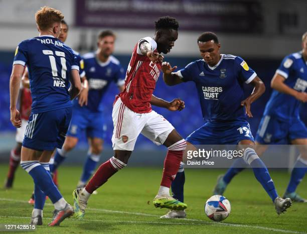 Flo Balogun of Arsenal takes on Corrie Ndaba of ipswich during the Leasingcom Cup match between Ipswich Town and Arsenal U21 at Portman Road on...