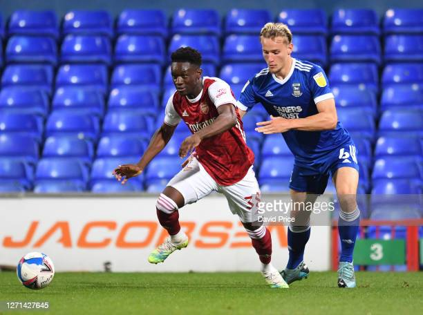 Flo Balogun of Arsenal takes on Luke Woolfenden of Ipswich during the Leasingcom Cup match between Ipswich Town and Arsenal U21 at Portman Road on...