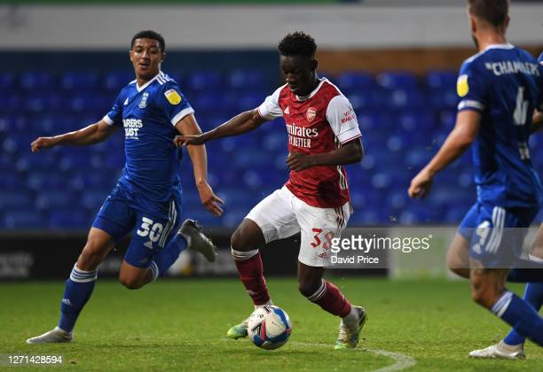 Flo Balogun of Arsenal takes on Myles Kenlock of Ipswich during the Leasingcom Cup match between Ipswich Town and Arsenal U21 at Portman Road on...