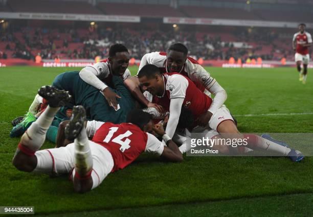 Flo Balogun Yassin Fortune and Josh Dasilva celebrate the winning penalty at the end of the match between Arsenal U23 and Villarreal U23 at Emirates...