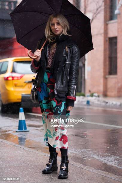 Flo Campbell is seen attending Public School during New York Fashion Week wearing a black leather jacket with a floral skirt on February 12 2017 in...
