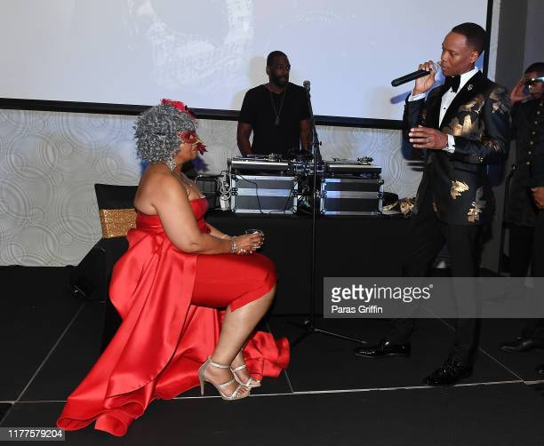 Flo DeVoe and Ronnie DeVoe onstage during DeVoe Family Celebration Masquerade Gala at EpiCenter on September 27 2019 in Austell Georgia