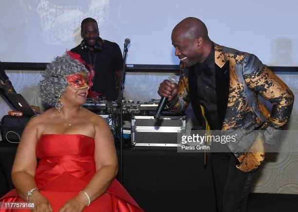 Flo DeVoe and singer Kem onstage during DeVoe Family Celebration Masquerade Gala at EpiCenter on September 27 2019 in Austell Georgia