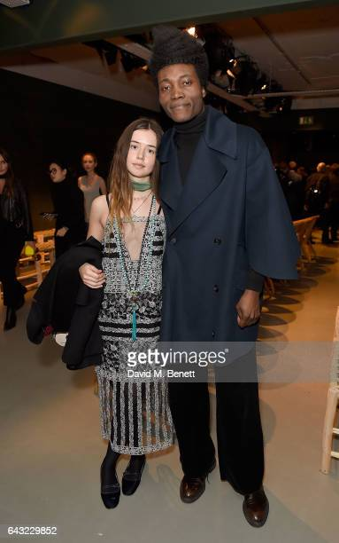 Flo Morrissey and Benjamin Clementine wearing Burberry attends the Burberry February 2017 Show during London Fashion Week February 2017 at Makers...