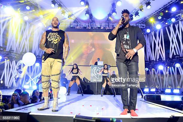 Flo Rida and Jason Derulo perform on stage during 2016 iHeartRadio Summer Pool Party at Fountainbleau Miami Beach on May 21 2016 in Miami Beach...