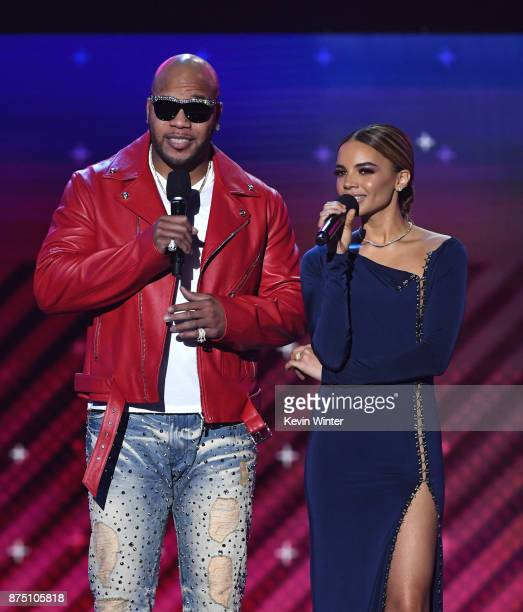 Flo Rida and Leslie Grace perform onstage at the 18th Annual Latin Grammy Awards at MGM Grand Garden Arena on November 16 2017 in Las Vegas Nevada