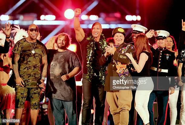 Flo Rida Jack Black Dwayne 'The Rock' Johnson Jeff Ross and others onstage during Spike's Rock the Troops event held at Joint Base Pearl Harbor...