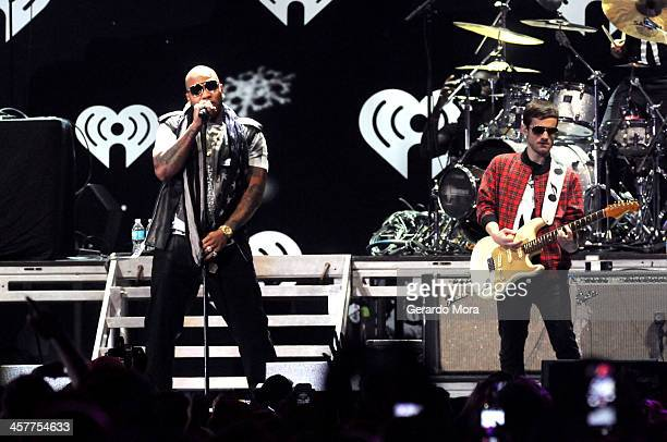 Flo Rida performs onstage during 933 FLZ's Jingle Ball 2013 at the Tampa Bay Times Forum on December 18 2013 in Tampa Florida