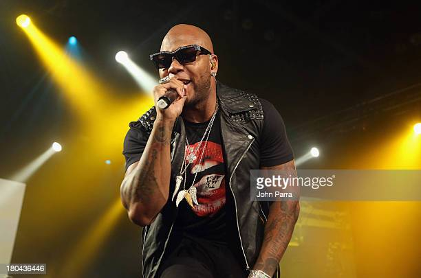 Flo Rida performs onstage during the Victoria's Secret PINK Nation Campus Party at University of Central Florida on September 12, 2013 in Orlando,...