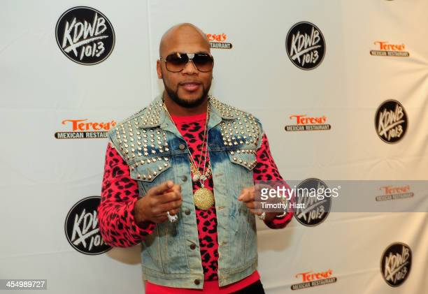 Flo Rida poses backstage at 101.3 KDWB's Jingle Ball 2013, at Xcel Energy Center on December 10, 2013 in St Paul, Minnesota.