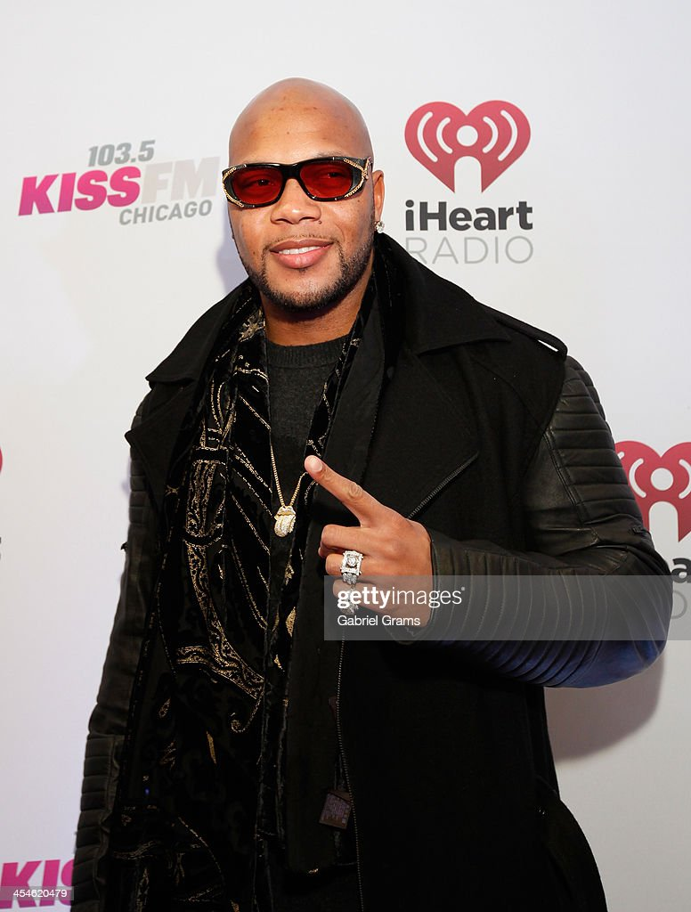 Flo Rida poses in the press room at 103.5 KISS FM's Jingle Ball 2013 at United Center on December 9, 2013 in Chicago, Illinois.