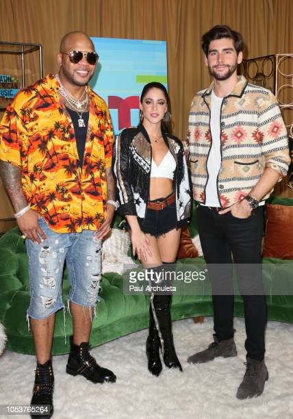 Flo Rida Tini Stoessel and Alvaro Soler pose in the press room at the 2018 Latin American Music Awards at Dolby Theatre on October 25 2018 in...
