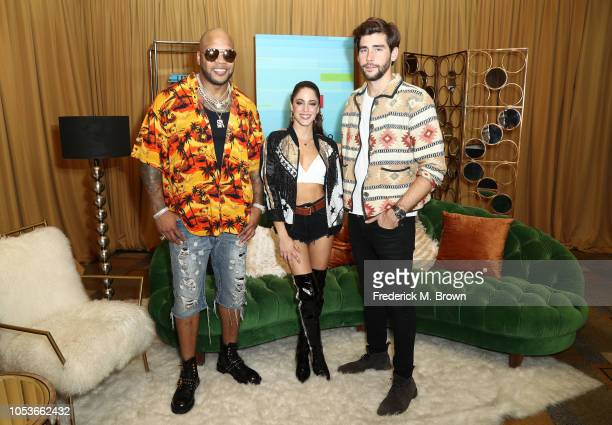 Flo Rida Tini Stoessel and Alvaro Soler pose in the press room during the 2018 Latin American Music Awards at Dolby Theatre on October 25 2018 in...