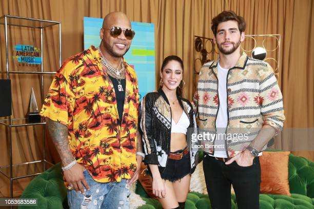 Flo Rida Tini Stoessel and Alvaro Soler poses at the 2018 Latin American Music Awards Press Room at Dolby Theatre on October 25 2018 in Hollywood...