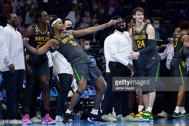 Flo Thamba and Jonathan Tchamwa Tchatchoua of the Baylor Bears react on the bench after defeating the Gonzaga Bulldogs in the National Championship...