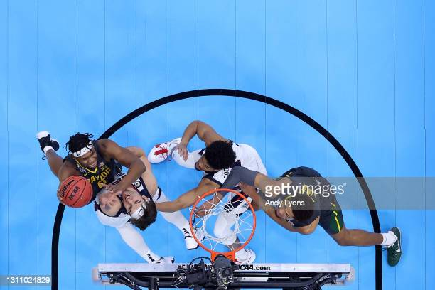 Flo Thamba of the Baylor Bears goes to the basket against Corey Kispert of the Gonzaga Bulldogs in the National Championship game of the 2021 NCAA...